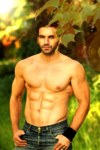 Outdoor portrait of a shirtless good looking fit male model