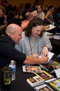 Me signing a book for Ethan (he forgot how to spell his name) at GRL Atlanta, 2013